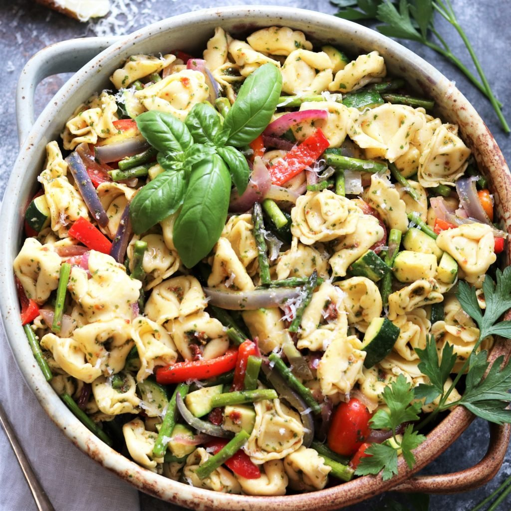 Basil Sun-dried Tomato Pesto Tortellini Salad | giveitsomethyme.com – an easy and delicious side dish recipe loaded with fresh roasted vegetables and coated in a deliciously intense pesto. A crowd-pleaser for year round entertaining you can make ahead! #tortellinisalad #tortellinisaladrecipes #tortellinisaladpesto #pastasalad #pastasaladrecipes #pastasaladforacrowd #pesto #basilpesto #sundriedtomatopesto #sundriedtomatorecipes #giveitsomethyme