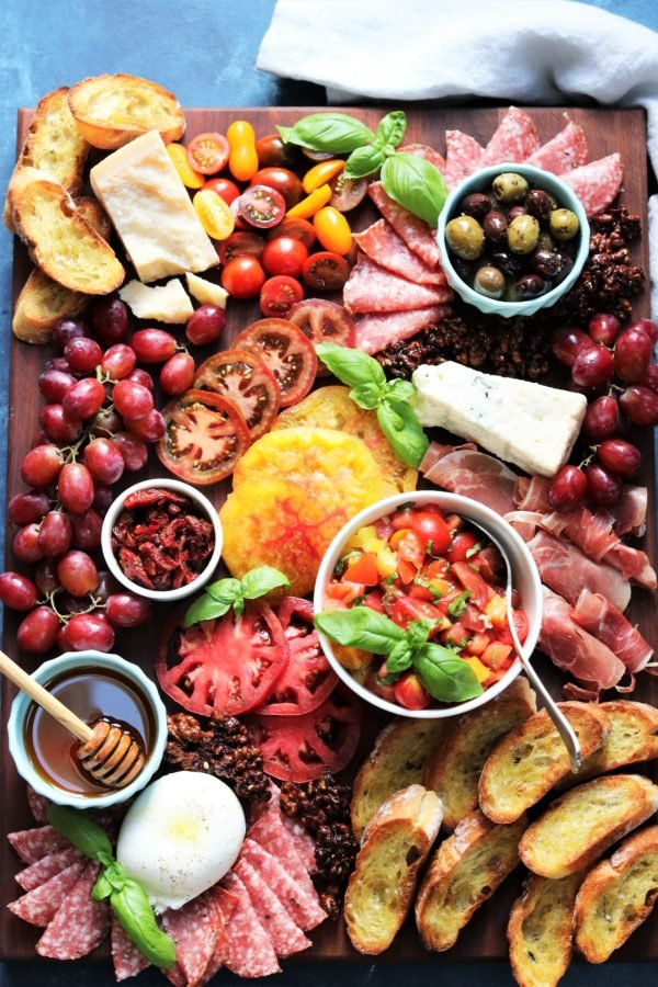 4th of July Party Menu Ideas - Heirloom Tomato Bruschetta Cheese Board | Give it Some Thyme – a delicious snacking display of heirloom tomato bruschetta with an assortment of Italian cheeses, charcuterie, toasted baguette and more! #heirloomtomatobruschetta #heirloomtomatobruschettarecipe #tomatobruschetta #cheeseandcharcuterieboard #cheeseandcharcuterieboardhowtomake #summerrecipes #july4thfood #giveitsomethyme