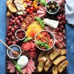 Ultimate Heirloom Tomato Bruschetta Cheese Board | Give it Some Thyme – a delicious snacking display of heirloom tomato bruschetta with an assortment of Italian cheeses, charcuterie, toasted baguette and more! #heirloomtomatobruschetta #heirloomtomatobruschettarecipe #tomatobruschetta #cheeseandcharcuterieboard #cheeseandcharcuterieboarddisplay #cheeseandcharcuterieboardideas #cheeseandcharcuterieboardhowtomake #giveitsomethyme #bestappetizers #bestappetizersever #bestappetizersforparties