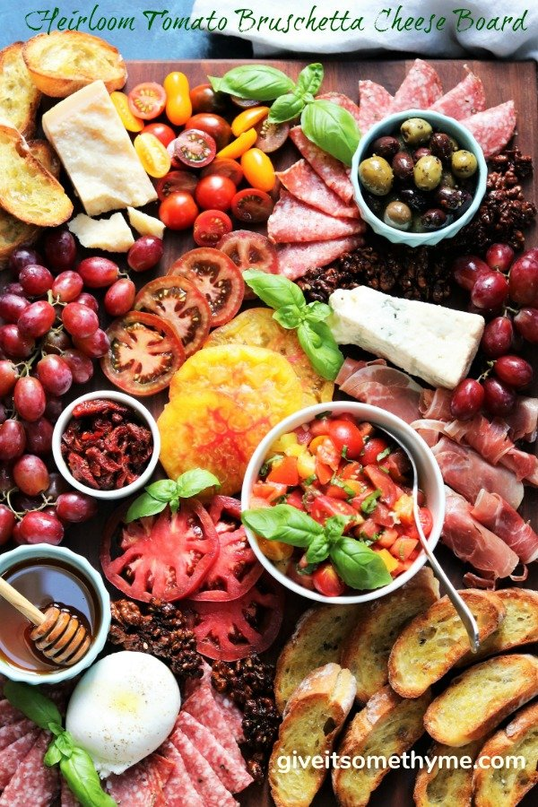 Heirloom Tomato Bruschetta Cheese Board - giveitsomethyme.com – a delicious snacking display of heirloom tomato bruschetta with an assortment of Italian cheeses, charcuterie, toasted baguette and more! #heirloomtomatobruschetta #heirloomtomatobruschettarecipe #tomatobruschetta #cheeseandcharcuterieboard #cheeseandcharcuterieboarddisplay #cheeseandcharcuterieboardideas #cheeseandcharcuterieboardhowtomake #giveitsomethyme #bestappetizers #bestappetizersever #bestappetizersforparties