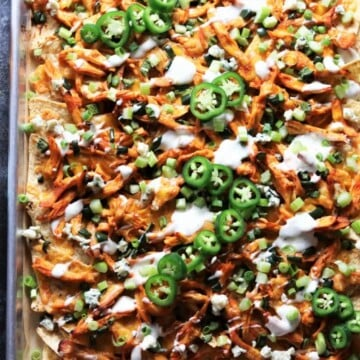 Sheet Pan Buffalo Chicken Nachos | giveitsomethyme.com – a super tasty, quick and easy appetizer perfect for game day snacking! #buffalochicken #buffalochickenrecipes #buffalochickennachos #bakedbuffalochicken #buffalochickennachossheetpan #buffalochickennachosbaked #buffalochickennachoseasy #sheetpanchicken #sheetpanchickeneasy #sheetpanrecipes #bakedchickenrecipes #gamedayfood #gamedayfoodfootball #gamedayfoodappetizers #gamedayfoodforacrowd #gamedayfoodeasy #gamedaybuffalochicken