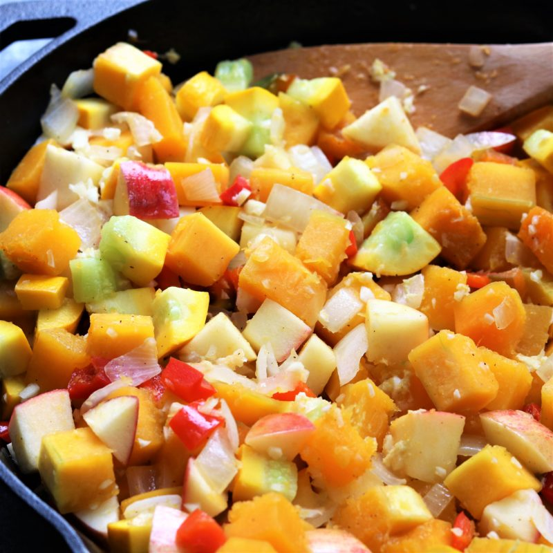 Butternut Squash, Apple and other Vegetables beginning to cook in cast iron skillet