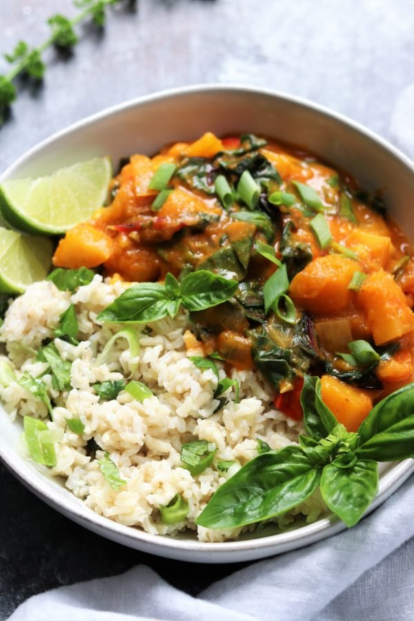 Thai Butternut Squash & Pumpkin Curry served with Steamed Rice | Give it Some Thyme – a rich, spicy and comforting vegan Thai curry recipe that's quick & easy and uses just one skillet! #healthyfalldinnerrecipes #thaicurry #redthaicurry #thaicurryrecipes #thaicurryvegan #giveitsomethyme #thaibutternutsquash #thaibutternutsquashcurry #thaibutternutsquashredcurry #thaivegancurry #thaipumpkincurry #thaipumpkincurryvegan #butternutsquashandpumpkinrecipes