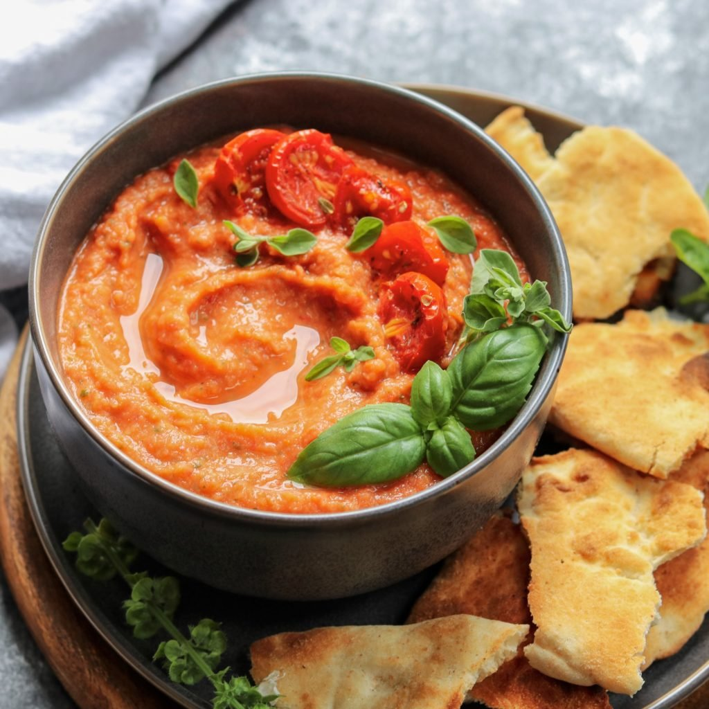 Roasted Tomato Garlic and White Bean Hummus | Give it Some Thyme – a delicious, creamy hummus recipe blending roasted San Marzano tomatoes, garlic, white beans, fresh basil and oregano! #giveitsomethyme #hummus #hummusrecipe #hummus #hummuswithouttahini #homemadehummus #roastedtomatohummus #veganhummus #glutenfree #superbowlfood #partyfood #giveitsomethyme