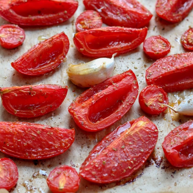 Roasted san marzano and cherry tomatoes and garlic cloves.