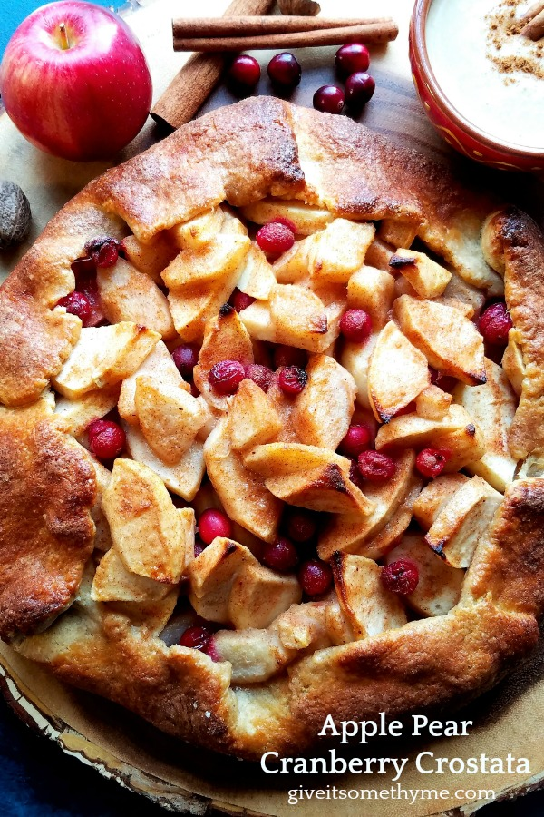 Apple Pear Cranberry Crostata   Give it Some Thyme – a delicious and festive holiday dessert served with a homemade pumpkin caramel sauce! #appledesserts #peardesserts #crostatarecipe #applecrostata #rusticcrosata #caramelsauce #fallgalette #galette #fallrecipes #holidaydesserts #giveitsomethyme