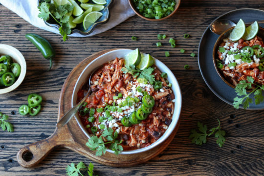 Slow Cooker Taco Chicken Chili | Give it Some Thyme – an easy crockpot recipe of tender shredded chicken bathing in the Mexican-spiced sauce is so hearty and delicious. Set it and forget it! #chilirecipes #slowcookerrecipes #crockpotrecipes #chickenchilirecipes #tacochickenchili #healthychilirecipes #chickenchili #healthyfalldinners #gamedayrecipes #crockpotchicken #glutenfreerecipes #giveitsomethyme
