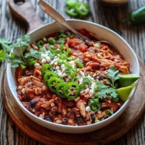 Slow Cooker Taco Chicken Chili Close Up | Give it Some Thyme – an easy crockpot recipe of tender shredded chicken bathing in the Mexican-spiced sauce is so hearty and delicious. Set it and forget it! #chilirecipe #slowcookerrecipe #crockpotrecipe #chickenchilirecipe #easychickenchilirecipe #tacochickenchili #healthychilirecipe #healthychickenchili #healthyfalldinners #gamedayrecipe #crockpotchicken #glutenfreerecipes #giveitsomethyme