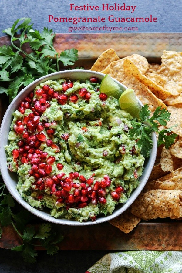 Festive Holiday Pomegranate Guacamole | Give it Some Thyme – ripe avocados, pomegranate arils, queso fresco, lime juice, and fresh herbs come together deliciously in this twist of the classic Mexican dip! #guacamole #guacamoleeasy #guacamolerecipe #guacamolediprecipes #pomegranateguacamole #pomegranateguacamolerecipe #pomegranate #giveitsomethyme