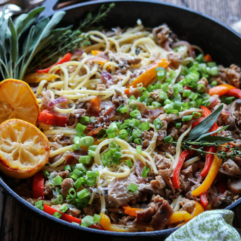 Pasta with Sausage & Fall Veggies | giveitsomethyme.com – a delicious recipe of linguine twirled with caramelized peppers, onions and mushrooms with zesty sausage and prosciutto in a dairy-free, creamy white wine Dijon sauce! #pastasausagerecipes #pastasausagerecipesskillets #pastasausagerecipescomfortfoods #pastaveggies #pastasausagedinner #pastadinner #pastadinnerrecipes #pastadinnerideas #pastadinnerparties #falldinnerideas #falldinnerrecipes #giveitsomethyme