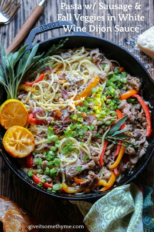 Pasta with Sausage and Fall Veggies | Give it Some Thyme – a delicious recipe of linguine twirled with caramelized peppers, onions and mushrooms with zesty sausage and prosciutto in a dairy-free, creamy white wine Dijon sauce! #pastasausagerecipes #pastasausagerecipesskillets #pastasausagerecipescomfortfoods #pastaveggies #pastasausagedinner #pastadinner #pastadinnerrecipes #pastadinnerideas #pastadinnerparties #falldinnerideas #falldinnerrecipes #giveitsomethyme