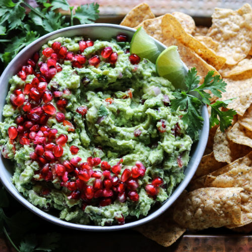 Festive Holiday Pomegranate Guacamole Dip | giveitsomethyme.com – ripe avocados, pomegranate arils, queso fresco, lime juice, and fresh herbs come together deliciously in this twist of the classic Mexican dip! #guacamole #guacamoleeasy #guacamolerecipe #guacamolediprecipes #pomegranateguacamole #pomegranateguacamolerecipe #pomegranate #giveitsomethyme