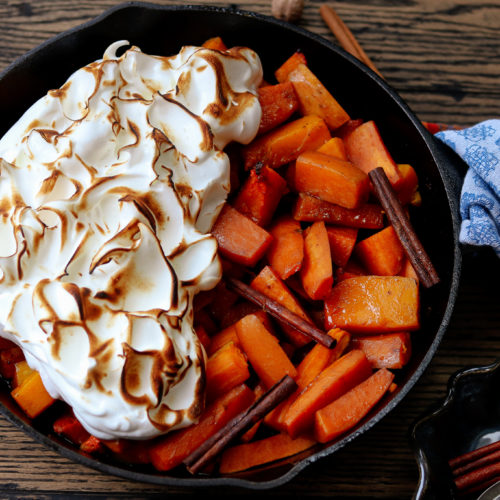 Cider Glazed Sweet Potatoes & Squash | giveitsomethyme.com - sweet potatoes and butternut squash bathe in an apple cider and maple syrup glaze infused with fall spices then topped with a fluffy meringue! #thanksgivingsides #thanksgivingsidedishes #thanksgivingsidedishrecipes #sweetpotatocasserole #sweetpotatocasseroleeasy #sweetpotatocasserolerecipe #ciderglazedsweetpotatoes #butternutsquash butternutsquashrecipes #giveitsomethyme