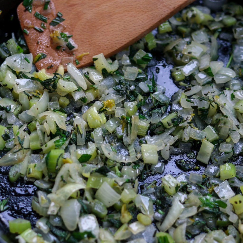 Onion Celery and Herbs Cooking in Skillet