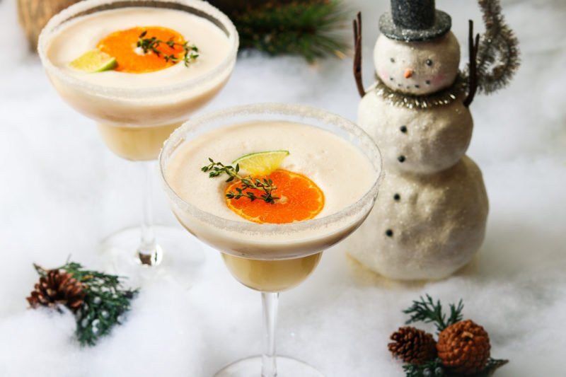 Frosty Citrus & Coconut Margaritas | giveitsomethyme.com – a grown up blend of tequila, Grand Marnier, orange and lime juice, coconut milk and ice. A perfect holiday cocktail! #frostymargaritas #citrusmargarita #citrusmargaritarecipe #margaritas #margaritasrecipes #margaritasforacrowd #margaritasandmistletoeparty #christmascocktails #christmascocktailsrecipes #dairyfreecocktails #dairyfreecocktailscoconutmilk #giveitsomethyme