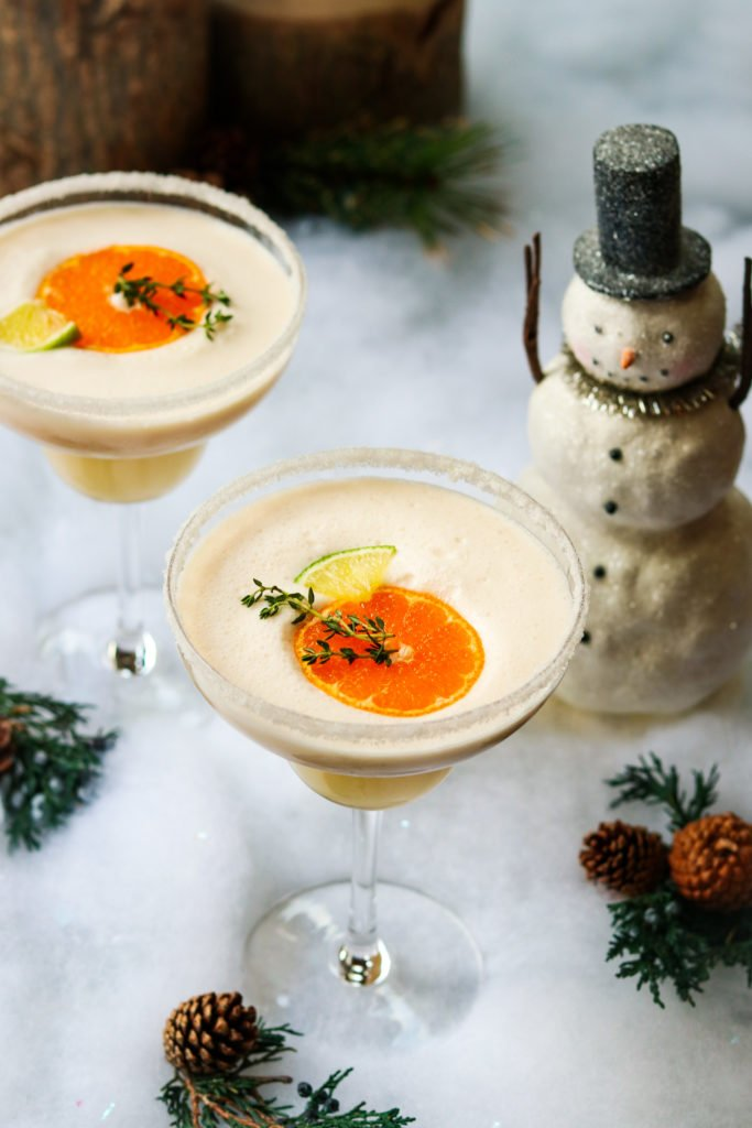 Frosty Citrus Margaritas - giveitsomethyme.com – a grown up blend of tequila, Grand Marnier, orange and lime juice, coconut milk and ice. A perfect holiday cocktail! #frostymargaritas #citrusmargarita #citrusmargaritarecipe #margaritas #margaritasrecipes #margaritasforacrowd #margaritasandmistletoeparty #christmascocktails #christmascocktailsrecipes #dairyfreecocktails #dairyfreecocktailscoconutmilk #giveitsomethyme