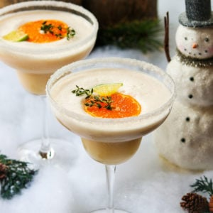 Frosty Citrus Margaritas - Give it Some Thyme – a grown up blend of tequila, Grand Marnier, orange and lime juice, coconut milk and ice. A perfect holiday cocktail! #frostymargaritas #citrusmargarita #citrusmargaritarecipe #margaritas #margaritasrecipes #margaritasforacrowd #margaritasandmistletoeparty #christmascocktails #christmascocktailsrecipes #dairyfreecocktails #dairyfreecocktailscoconutmilk #giveitsomethyme
