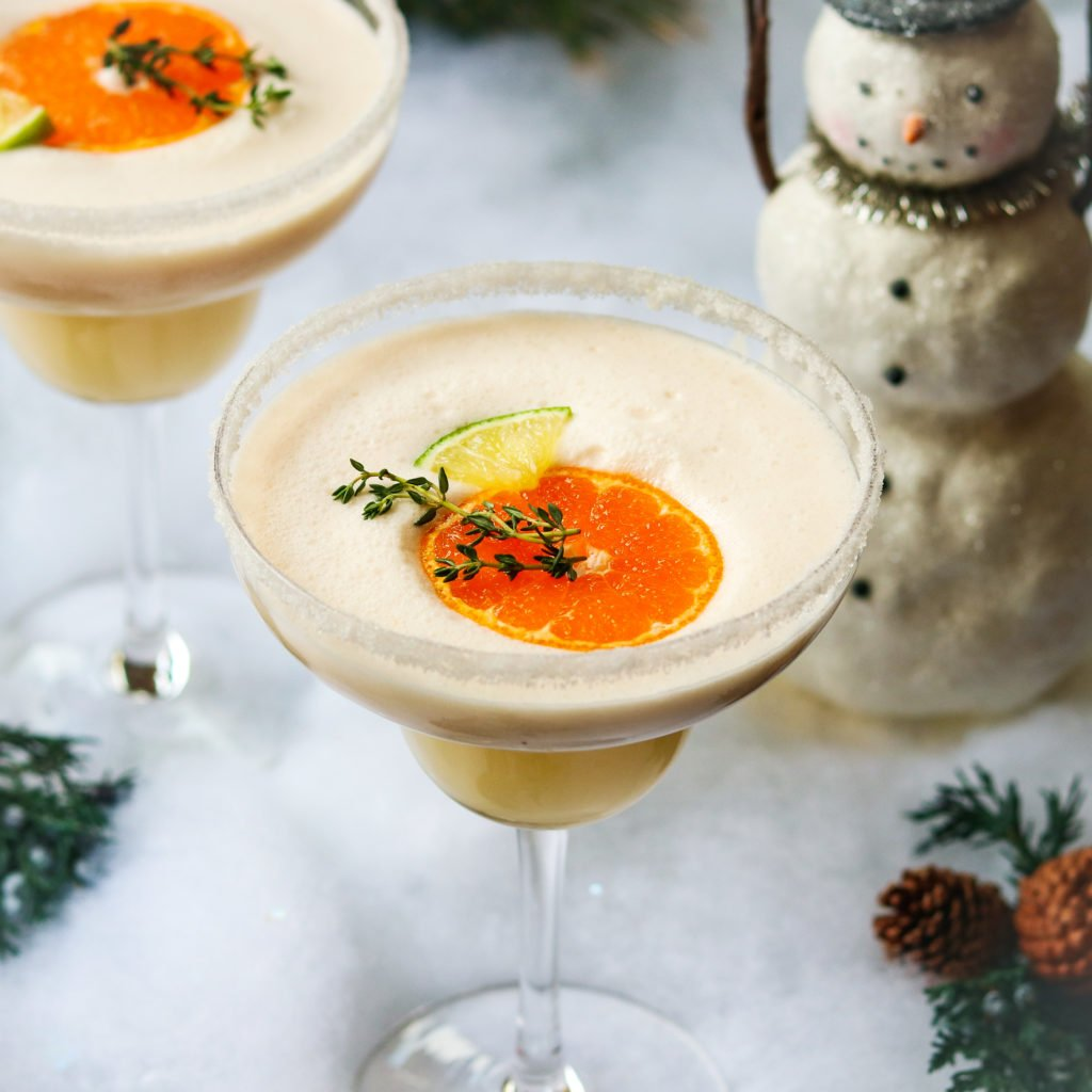 Frosty Citrus & Coconut Margaritas | Give it Some Thyme – a grown up blend of tequila, Grand Marnier, orange and lime juice, coconut milk and ice. A perfect holiday cocktail! #frostymargaritas #citrusmargarita #citrusmargaritarecipe #margaritas #margaritasrecipes #margaritasforacrowd #margaritasandmistletoeparty #christmascocktails #christmascocktailsrecipes #dairyfreecocktails #dairyfreecocktailscoconutmilk #giveitsomethyme