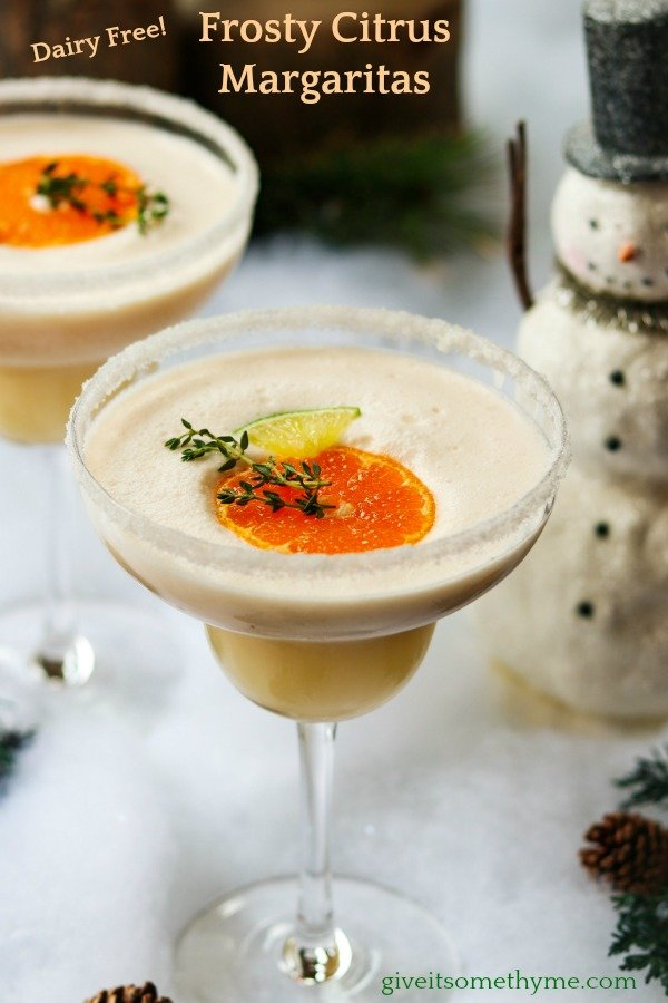 Frosty Citrus Margaritas | Give it Some Thyme – a grown up blend of tequila, Grand Marnier, orange and lime juice, coconut milk and ice. A perfect holiday cocktail! #frostymargaritas #citrusmargarita #citrusmargaritarecipe #margaritas #margaritasrecipes #margaritasforacrowd #margaritasandmistletoeparty #christmascocktails #christmascocktailsrecipes #dairyfreecocktails #dairyfreecocktailscoconutmilk #giveitsomethyme