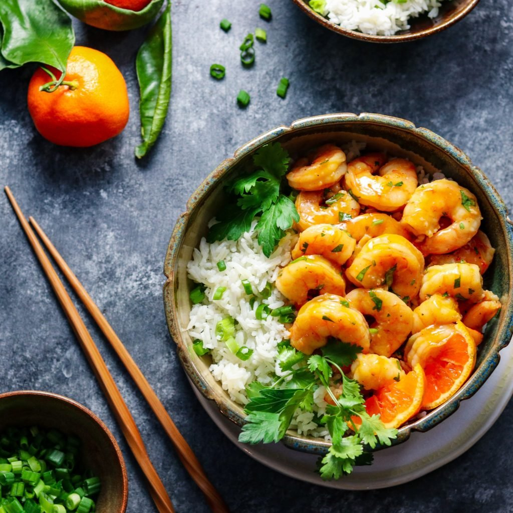 Orange & Honey Glazed Shrimp - Give it Some Thyme – an easy and delicious recipe of tender plump shrimp in a sweet n' spicy orange glaze served with jasmine rice! #orangeglazedshrimp #orangeshrimp #orangeshrimprecipes #easyorangeshrimp #chineseorangeshrimp #shrimpdinner #shrimpdinnerrecipes #shrimpdinnerideas #shrimpdinnerhealthy #orangeandhoneyglaze #giveitsomethyme