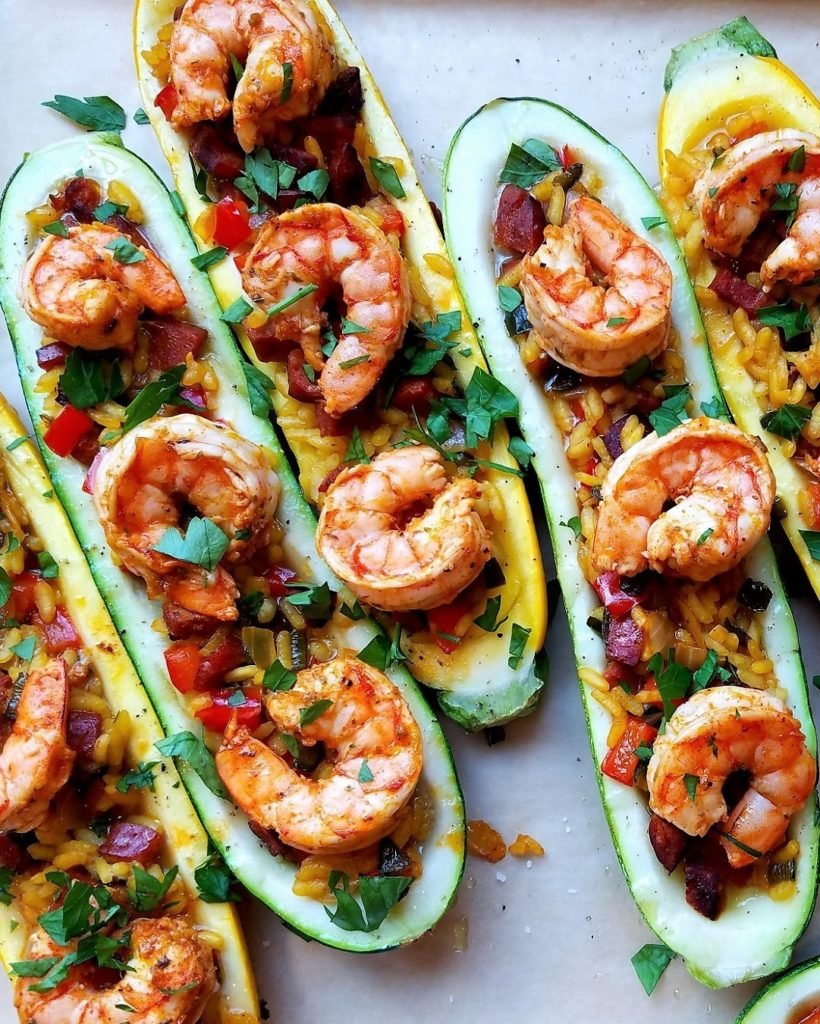 Paella Stuffed Zucchini w/ Shrimp & Chorizo | Give it Some Thyme - Anchor into this gluten and dairy free, saffron-kissed Spanish-inspired recipe complete with plump shrimp and savory chorizo! #paella #paellarecipe #paellarecipeseafood #shrimppaella #shrimppaellarecipe #stuffedzucchini #stuffedzucchiniboats #stuffedzucchinirecipes #july4thfood #giveitsomethyme
