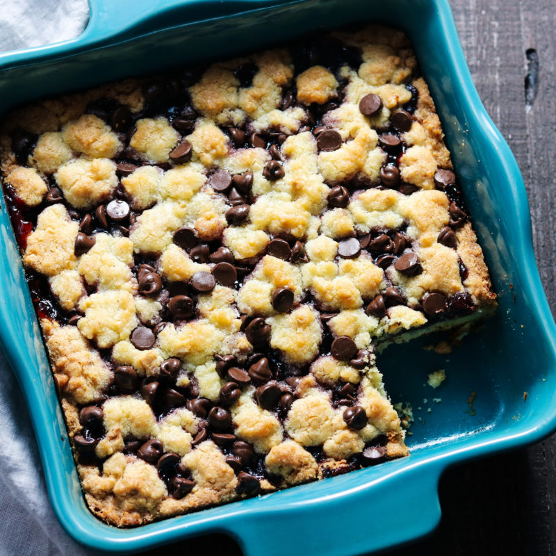 Cookie bars baked in blue square baking dish.