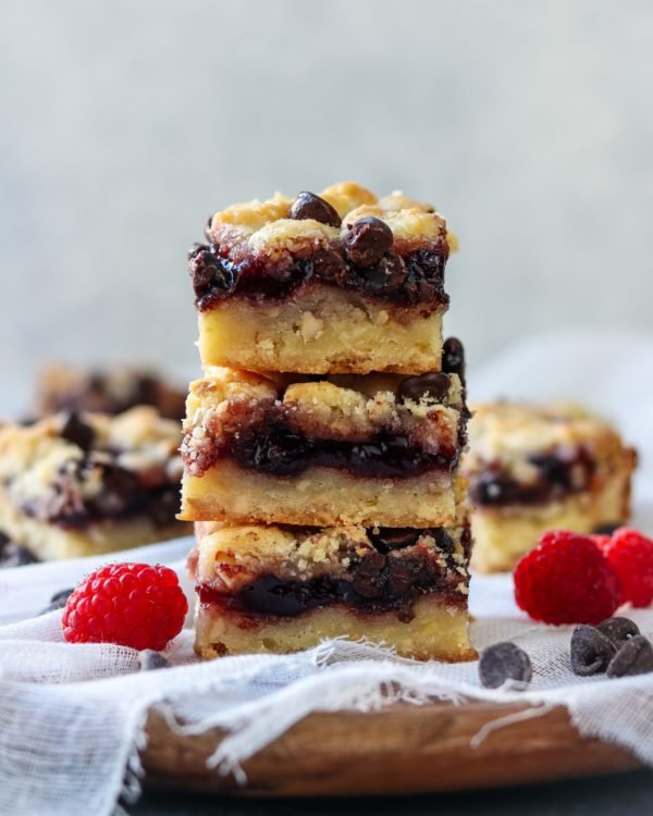 Close up of Raspberry Chocolate Chip Crumb Bars stacked.