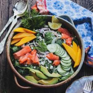 Smoked Salmon Spinach Salad w/ Lemon Dijon Vinaigrette | giveitsomethyme.com - a delicious entrée salad loaded with fennel, cucumber, red onion, mango, avocado and goat cheese! #smokedsalmon #smokedsalmonrecipes #smokedsalmonsalad #giveitsomethyme #spinachandsmokedsalmonsalad #spinachsalad #spinachsaladrecipes #easyspinachsalad #easyspinachsaladhealthy #entreesalads #entresaladseasydinners #entreesaladshealthy