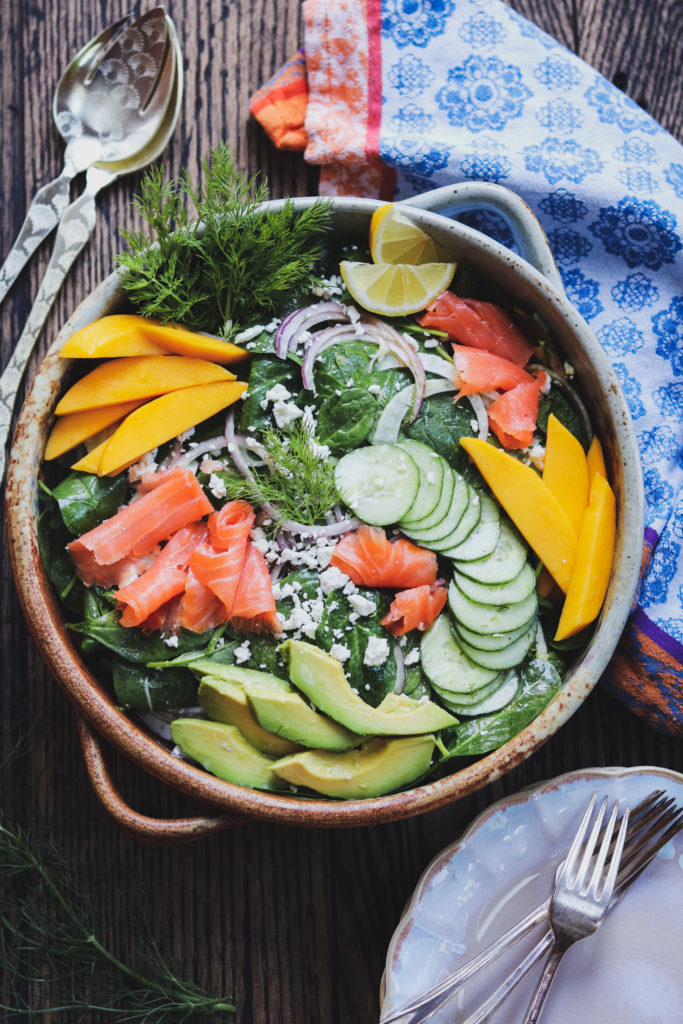 Smoked Salmon Spinach Salad w/ Lemon Dijon Vinaigrette - Give it Some Thyme - a delicious entrée salad loaded with fennel, cucumber, red onion, mango, avocado and goat cheese! #smokedsalmon #smokedsalmonrecipes #smokedsalmonsalad #giveitsomethyme #spinachandsmokedsalmonsalad #spinachsalad #spinachsaladrecipes #easyspinachsalad #easyspinachsaladhealthy #entreesalads #entresaladseasydinners #entreesaladshealthy