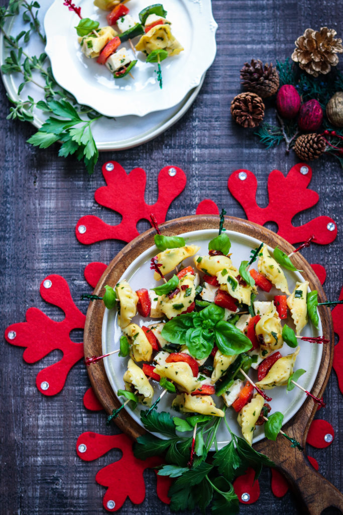 Festive Marinated Tortellini Skewers - giveitsomethyme.com – an easy recipe of tortellini, fresh mozzarella and bell peppers marinated in a zesty lemon vinaigrette! #tortelliniskewers #tortelliniskewersappetizers #marinatedtortelliniskewers #pastaappetizers #pastaappetizerseasy #pastaappetizerspartiesfood #christmasappetizers #christmasappetizerseasy #holidayappetizers #holidayappetizerseasy #giveitsomethyme