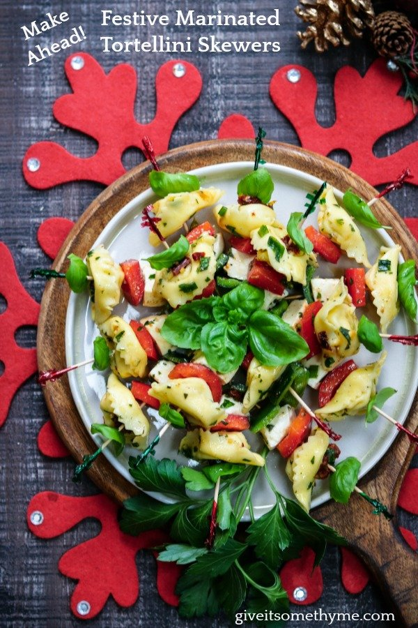 Festive Marinated Tortellini Skewers   Give it Some Thyme – an easy recipe of tortellini, fresh mozzarella and bell peppers marinated in a zesty lemon vinaigrette! #tortelliniskewers #tortelliniskewersappetizers #marinatedtortelliniskewers #pastaappetizers #pastaappetizerseasy #pastaappetizerspartiesfood #christmasappetizers #christmasappetizerseasy #holidayappetizers #holidayappetizerseasy #giveitsomethyme