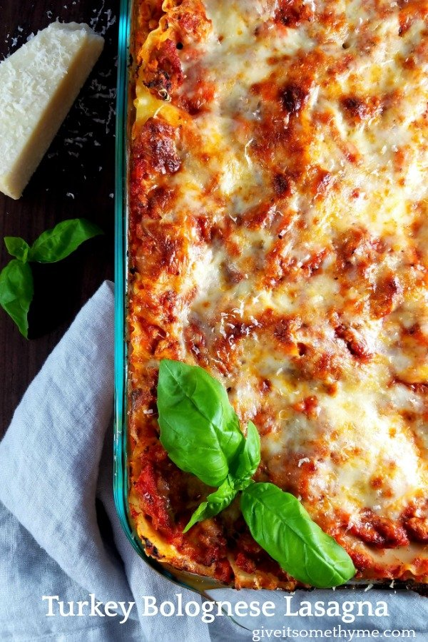 Turkey Bolognese Lasagna   Give it Some Thyme – a delicious make-ahead, crowd-pleasing recipe that combines all the great flavors of a traditional bolognese with a tad less guilt using ground turkey and turkey sausage. #lasagna #lasagnarecipe #homemadelasagna #turkeylasagna #pastadinner #pastadinnerrecipes #pastadinnerideas #pastadinnerparties #falldinnerideas #falldinnerrecipes #giveitsomethyme
