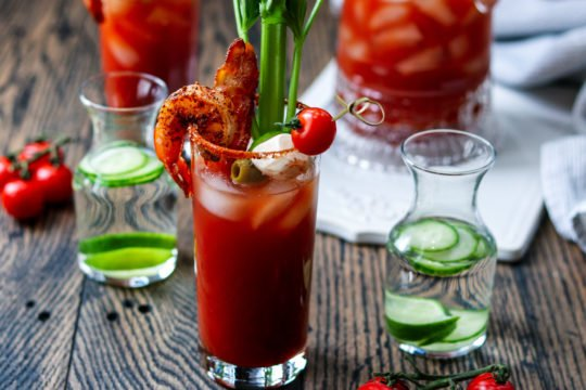 Cucumber Lime Bloody Mary | giveitsomethye.com - add cool, citrusy flavor with cucumber-lime infused vodka in this heavily garnished Bloody Mary. A cocktail and appetizer all in one! #bloodymary #bloodymaryrecipe #bloodymarybar #bloodymarybarideas #bloodymarymix #bloodymaryeasy #cucumberlimebloodymary #cucumberlimevodka #cucumberlimevodkadrinks #cocktails #cocktailswithvodka #giveitsomethyme