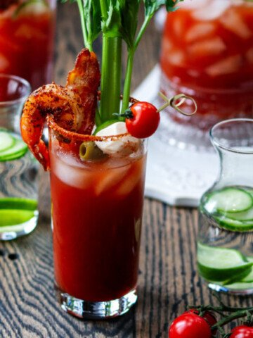 Cucumber Lime Bloody Mary   giveitsomethye.com - add cool, citrusy flavor with cucumber-lime infused vodka in this heavily garnished Bloody Mary. A cocktail and appetizer all in one! #bloodymary #bloodymaryrecipe #bloodymarybar #bloodymarybarideas #bloodymarymix #bloodymaryeasy #cucumberlimebloodymary #cucumberlimevodka #cucumberlimevodkadrinks #cocktails #cocktailswithvodka #giveitsomethyme
