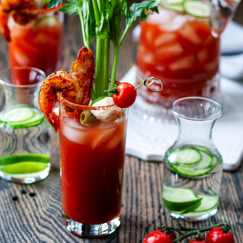 Bloody Mary w/ Cucumber-Lime Vodka | Give it Some Thyme - add cool, citrusy flavor with cucumber-lime infused vodka in this heavily garnished Bloody Mary. A cocktail and appetizer all in one! #bloodymary #bloodymaryrecipe #bloodymarybar #bloodymarybarideas #bloodymarymix #bloodymaryeasy #cucumberlimebloodymary #cucumberlimevodka #cucumberlimevodkadrinks #cocktails #cocktailswithvodka #giveitsomethyme