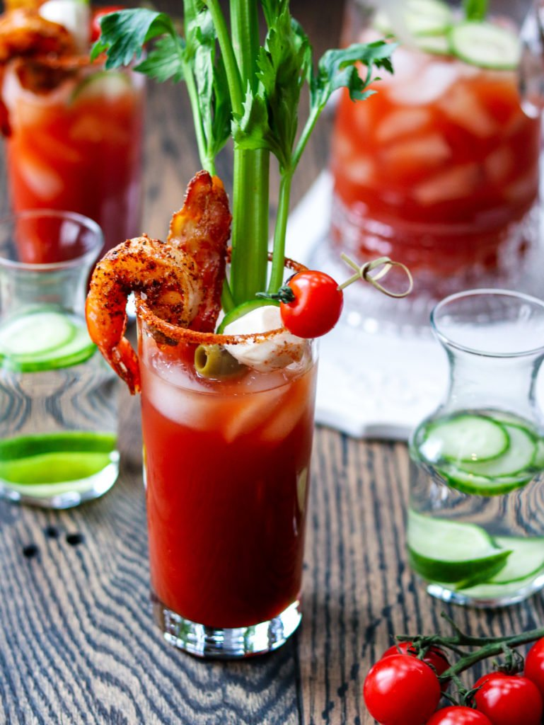 Bloody Mary w/ Cucumber-Lime Vodka - giveitsomethyme.com - add cool, citrusy flavor with cucumber-lime infused vodka in this heavily garnished Bloody Mary. A cocktail and appetizer all in one! #bloodymary #bloodymaryrecipe #bloodymarybar #bloodymarybarideas #bloodymarymix #bloodymaryeasy #cucumberlimebloodymary #cucumberlimevodka #cucumberlimevodkadrinks #cocktails #cocktailswithvodka #giveitsomethyme