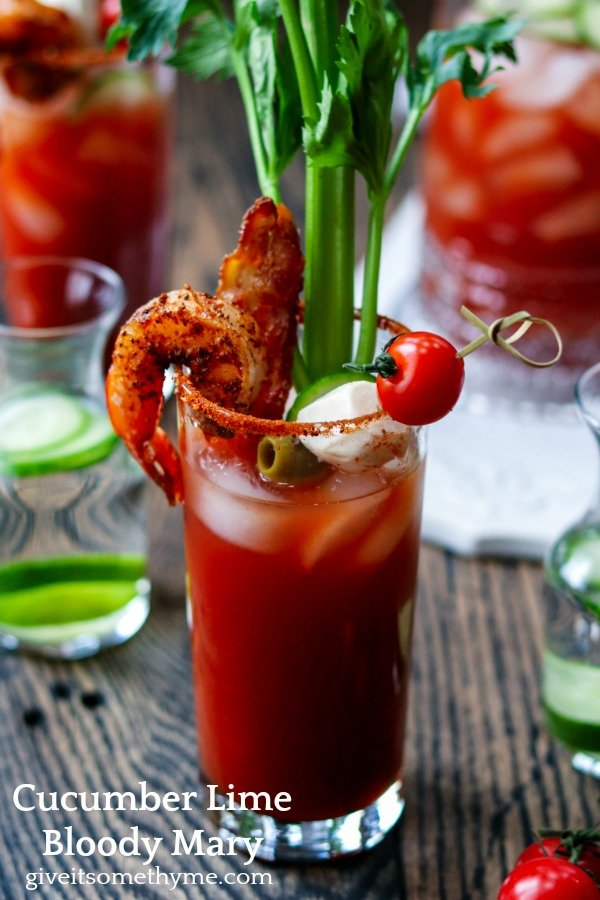 Cucumber Lime Bloody Mary | Give it Some Thyme - add cool, citrusy flavor with cucumber-lime infused vodka in this heavily garnished Bloody Mary. A cocktail and appetizer all in one! #bloodymary #bloodymaryrecipe #bloodymarybar #bloodymarybarideas #bloodymarymix #bloodymaryeasy #cucumberlimebloodymary #cucumberlimevodka #cucumberlimevodkadrinks #cocktails #cocktailswithvodka #giveitsomethyme