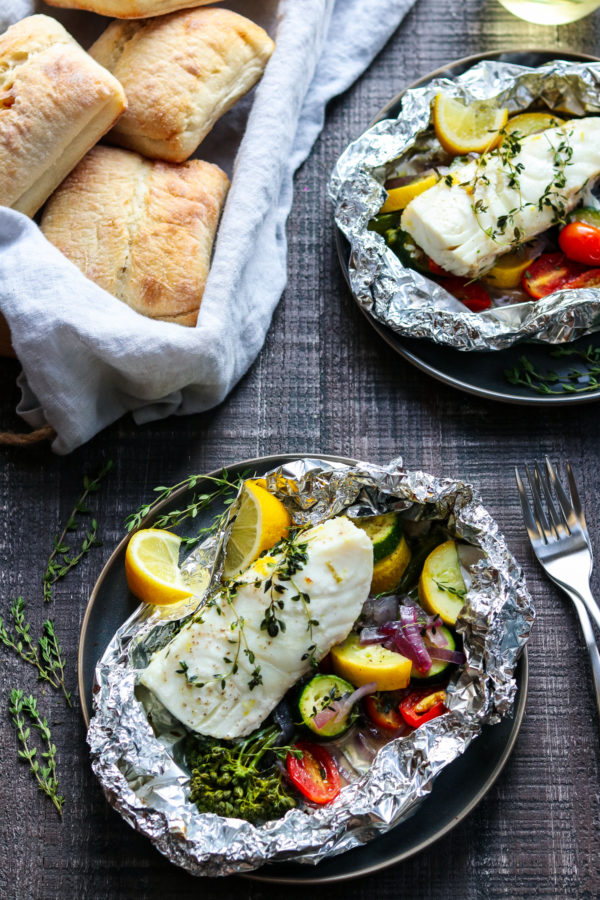 Grilled Halibut Broccolini & Zucchini Packets - flaky halibut on a bed of fresh veggies laced with lemon, white wine, and thyme! #keto #glutenfree #summerrecipes #fishdinner #fishdinnerrecipes #fishdinnerideas #healthydinners #quickandeasydinners #halibut #besthalibutrecipes #foilpackets #giveitsomethyme | giveitsomethyme.com