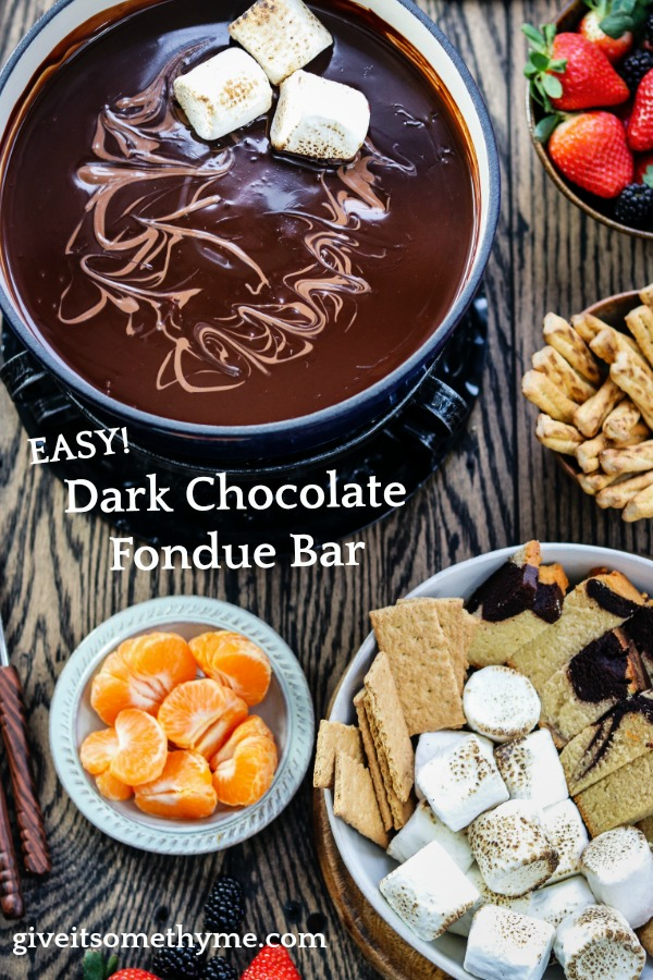 Easy Dark Chocolate Fondue Bar | Give it Some Thyme – luxuriously smooth, rich dark chocolate fondue with a bar of delcious dipping treats is what chocolate lovers dreams are made of! #darkchocolatefondue #darkchocolatefonduerecipe #darkchocolatefondueparties #chocolatefondue #chocolatefonduebar #easychocolatefondue #chocolatefonduedippers #valentinesdaydesserts #valentinesdaydessertideas #valentinesdaydessertsrecipes #giveitsomethyme
