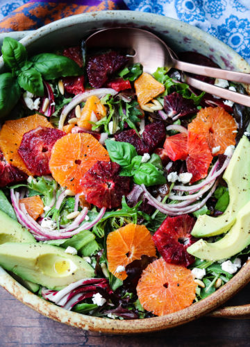 Winter Citrus Salad with Avocado and Goat Cheese | Give it Some Thyme – quick + easy winter salad full of sweet, bright cara cara and blood oranges tossed with baby greens and drizzled with an orange honey vinaigrette. #salad #citrussalad #citrussaladrecipes #citrussaladdressing #citrussaladwinter #orangecitrussalad #orangecitrussaladgoatcheese #mixedgreensalad #giveitsomethyme #entreesalads #entreesaladshealthy