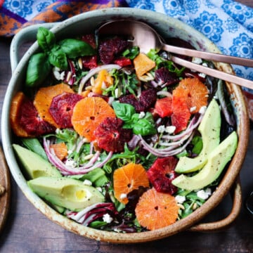 Winter Citrus Salad with Avocado and Goat Cheese   Give it Some Thyme – quick + easy winter salad full of sweet, bright cara cara and blood oranges tossed with baby greens and drizzled with an orange honey vinaigrette. #salad #citrussalad #citrussaladrecipes #citrussaladdressing #citrussaladwinter #orangecitrussalad #orangecitrussaladgoatcheese #mixedgreensalad #giveitsomethyme #entreesalads #entreesaladshealthy
