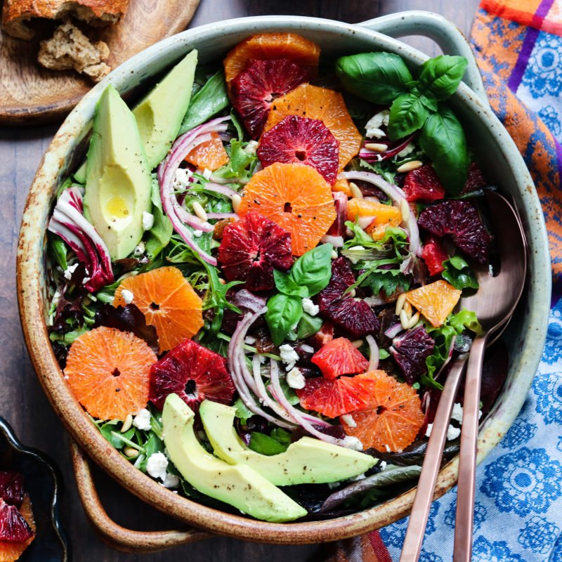 Winter Citrus Salad w/ Avocado & Goat Cheese | giveitsomethyme.com – quick + easy winter salad full of sweet, bright cara cara and blood oranges tossed with baby greens and drizzled with an orange honey vinaigrette. #salad #citrussalad #citrussaladrecipes #citrussaladdressing #citrussaladwinter #orangecitrussalad #orangecitrussaladgoatcheese #mixedgreensalad #giveitsomethyme #entreesalads #entreesaladshealthy