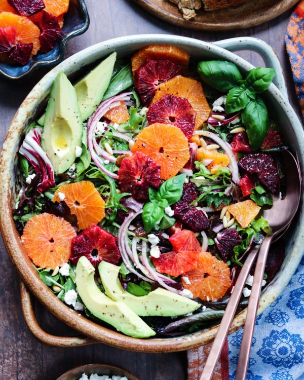Winter Citrus Salad with Avocado and Goat Cheese - giveitsomethyme.com – quick + easy winter salad full of sweet, bright cara cara and blood oranges tossed with baby greens and drizzled with an orange honey vinaigrette. #salad #citrussalad #citrussaladrecipes #citrussaladdressing #citrussaladwinter #orangecitrussalad #orangecitrussaladgoatcheese #mixedgreensalad #giveitsomethyme #entreesalads #entreesaladshealthy