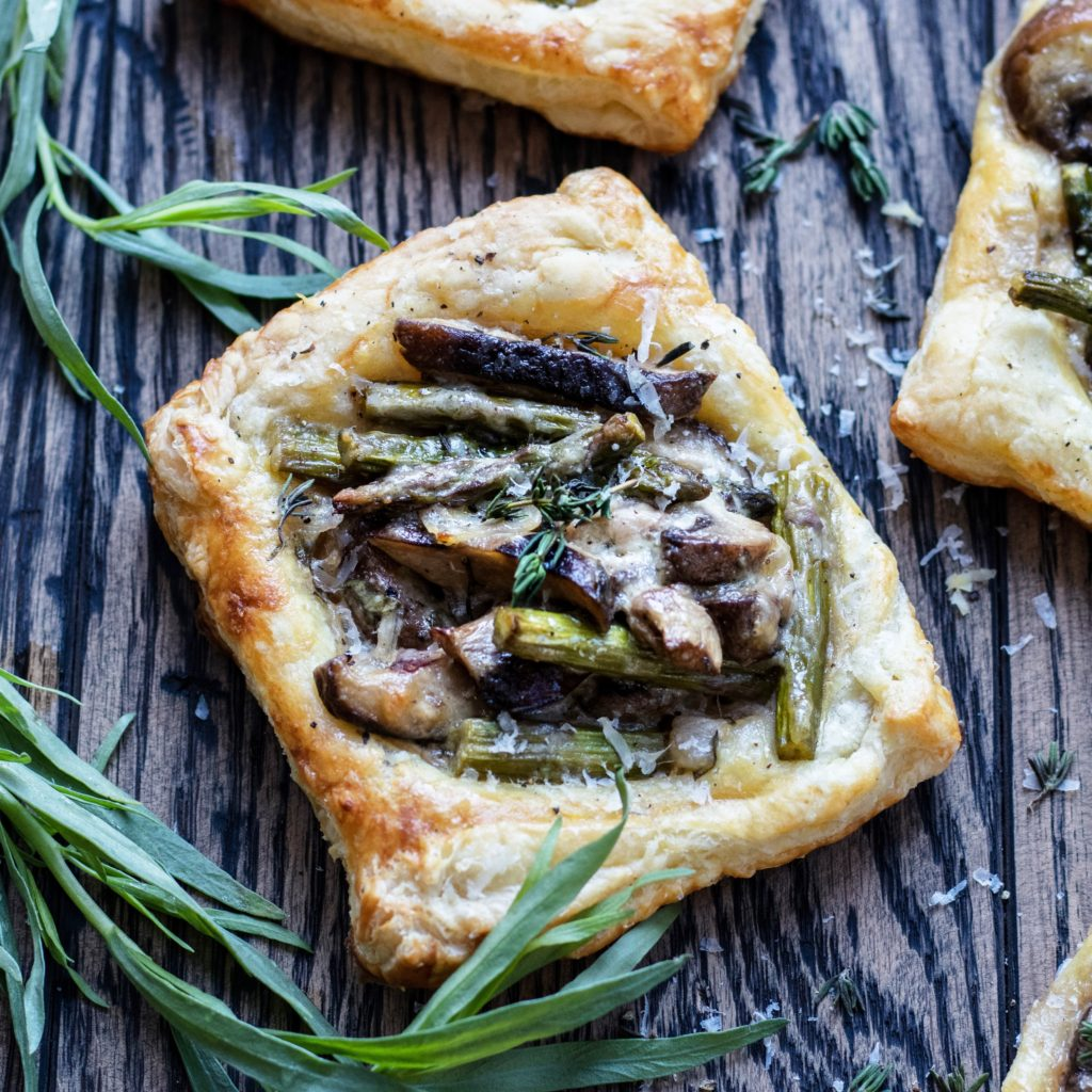 Asparagus Mushroom & Goat Cheese Pastry Tarts - Give it Some Thyme – an easy and delicious appetizer or side dish you can prep ahead! #asparagusrecipes #asparagustarts #springrecipes #springrecipesvegetarian #asparagustartspuffpastries #asparagusmushroomrecipes #puffpastryrecipes #puffpastryappetizers #asparagusmushroomtart #asparagusmushroomtartgoatcheese #vegetarianappetizers #vegetariansides #vegetariansidedishes #giveitsomethyme