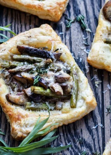 Asparagus Mushroom and Goat Cheese Pastry Tarts | Give it Some Thyme – an easy and delicious appetizer or side dish you can prep ahead! #asparagusrecipes #asparagustarts #springrecipes #springrecipesvegetarian #asparagustartspuffpastries #asparagusmushroomrecipes #puffpastryrecipes #puffpastryappetizers #asparagusmushroomtart #asparagusmushroomtartgoatcheese #vegetarianappetizers #vegetariansides #vegetariansidedishes #giveitsomethyme