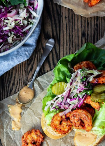Seared Shrimp Po' Boys with Creole Slaw | Give it Some Thyme – a delicious, quick and easy healthier twist on this creole classic! #shrimppoboy #shrimppoboysandwich #shirmppo'boyrecipe #easyshrimppoboy #shrimppoboyneworleans #searedshrimppoboys #po'boysandwich #po'boyrecipes #mardigrasfood #mardigrasfooddinners #mardigrasfoodeasy #fattuesday #fattuesdayfood #fattuesdayrecipes #giveitsomethyme