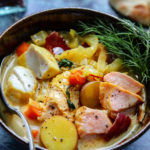 Saffron Fish Chowder with Leeks & Fennel Close Up | Give it Some Thyme – quick, easy, and deliciously light, bouillabaisse-style chowder with hunks of salmon, mahi-mahi, leeks, fennel, and potatoes. Dairy free and gluten free! #fishchowder #fishchowderrecipe #dairyfreechowder #dairyfreefishchowder #dairyfreefishchowdercoconutmilk #glutenfreeanddairyfree #glutenfreeanddairyfreereicpes #glutenfreeanddairyfreemeals #glutenfreeanddairyfreesoup #giveitsomethyme