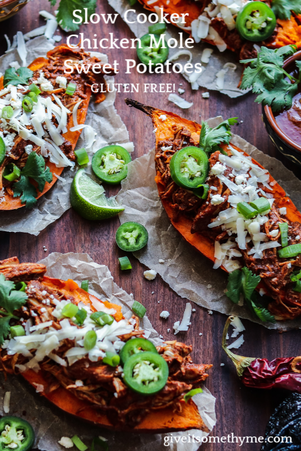 Slow Cooker Chicken Mole Stuffed Sweet Potatoes | Give it Some Thyme - tender shredded chicken bathes in a perfectly spiced and tasty mole sauce with sweet potatoes perfectly complementing this classic Mexican dish! #mexicandinner #stuffedsweetpotatoes #chickenmole #chickenmolerecipe #chickenmoleeasy #chickenmolecrockpot #chickenmoleslowcooker #slowcookerrecipe #crockpotrecipes #crockpotrecipeschicken #giveitsomethyme