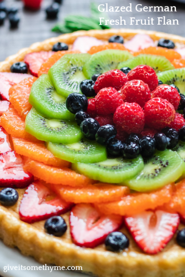 Glazed German Fresh Fruit Flan | Give it Some Thyme – a classic, delicious recipe showcasing beautiful fruit on light, lemon-scented spongecake! #fruitflan #fruitflantart #fruitflanrecipe #germanfruitflan #germanfruitflanrecipe #easterdesserts #springdessertideas #springdessertrecipes #springdesserts #fruitdesserts #fruitdessertrecipes #giveitsomethyme