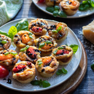Cherry Tomato & Pancetta Mini Quiches   giveitsomethyme.com – a delicious and easy mini quiche recipe perfect for brunch or snacking any time of day! #miniquiche #miniquicherecipe #miniquichesinmuffintin #easterbrunchfood #easterbrunchideas #mothersdaybrunch #mothersdaybrunchideas #brunch #brunchrecipes #brunchideas #appetizers #giveitsomethyme
